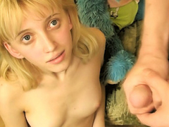 Lengthy legged blonde teen shows off her tight hairless pussy